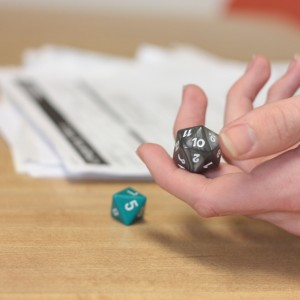 A Dungeons & Dragons player prepares to throw the dice.