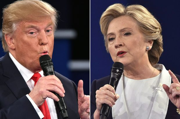 (COMBO) This combination of pictures created on October 09, 2016 shows Republican presidential candidate Donald Trump and Democratic presidential candidate Hillary Clinton during the second presidential debate at Washington University in St. Louis, Missouri on October 9, 2016.  / AFP / Paul J. Richards        (Photo credit should read PAUL J. RICHARDS/AFP/Getty Images)